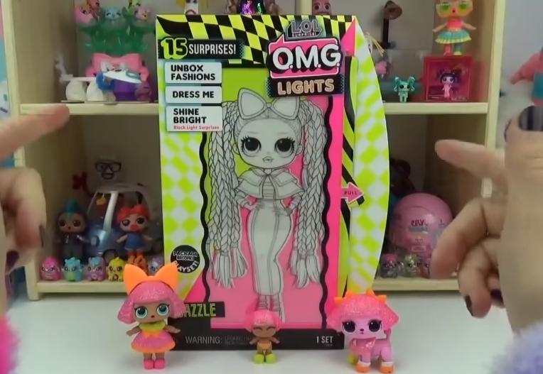 LOL Surprise O.M.G. Lights UV Black Light Surprise Doll DAZZLE Glowing Surprises 1